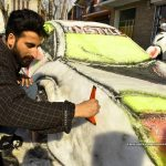 Youth Makes Car Out Of Snow In Jammu And Kashmir's Srinagar